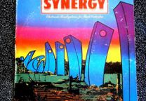 Sinergy Electronic Realizations for Rock Orchestra